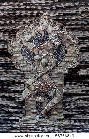 A picturesque stone wall mosaic of a woman in Nha Trang Vietnam.