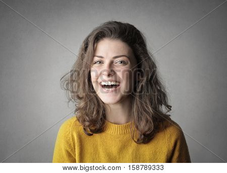 Young woman making a big smile