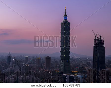 Sunset of cityscape nightlife view of Taipei. Taiwan city skyline at twilight time public scene from view point at Elephant Mountain Hiking Trail. (Purple tone)
