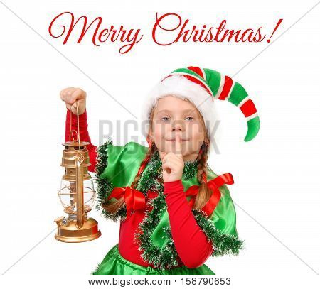 Girl in suit of Christmas elf with oil lamp with finger over her mouth. Isolated on a white