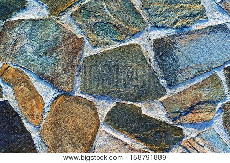 stone mosaic of a floor or wall closeup for an abstract background and for wallpaper of motley color