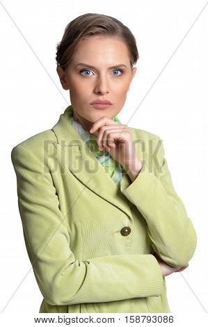 Portrait of beautiful serious young woman looking at camera isolated on white background