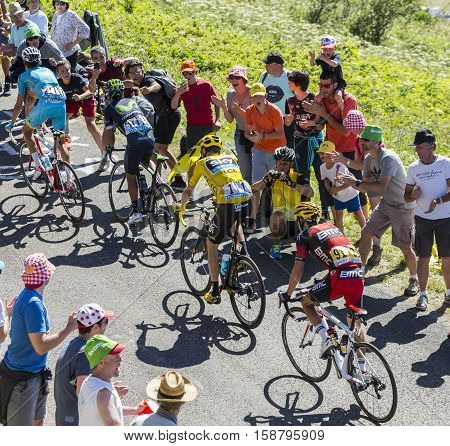 Col du Grand ColombierFrance - July 17 2016: Group of important general classification (GC) cyclists including Froome in Yellow Jersey riding on the road to Col du Grand Colombier in Jura Mountains during the stage 15 of Tour de France 2016.