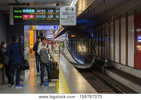 Tokyo, Japan - NOV 18, 2016: Passengers waiting for Keisei Skyliner train at Narita international airport. connecting Narita Airport to the heart of Tokyo in as little as 41 minutes.