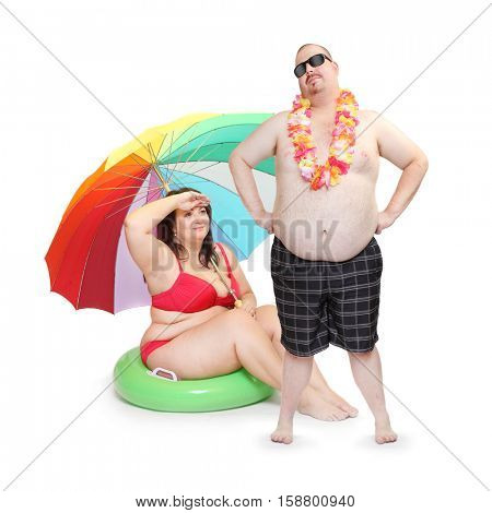 Obese couple in swimsuit with tropical flowers. Funny people enjoying holidays on the beach. Studio shot of two persons on white background.