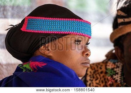 Lesedi Cultural Village, SOUTH AFRICA - 4 November 2016: Portrait of a young Zulu woman in colourful traditional bead work costume.