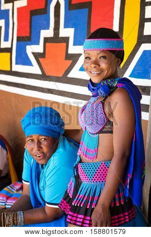 Lesedi Cultural Village, SOUTH AFRICA - 4 November 2016: Zulu women in colourful traditional bead work costume.