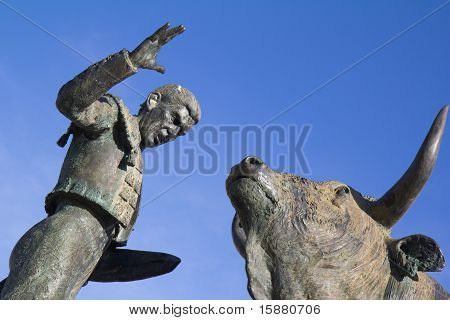 Sculpture of a torero in front of his fight bull