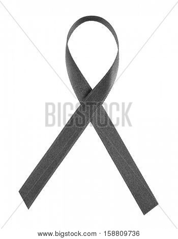 Black ribbon on white background. Melanoma and mourning concept