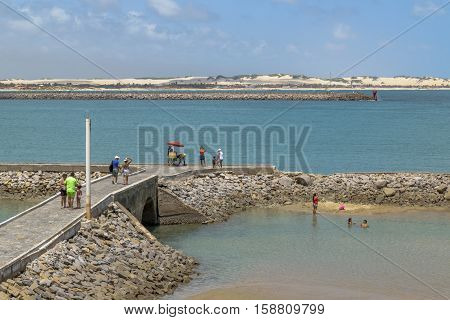 NATAL, BRAZIL, JANUARY - 2016 - People at rocky breakwater at beach in Natal Brazil