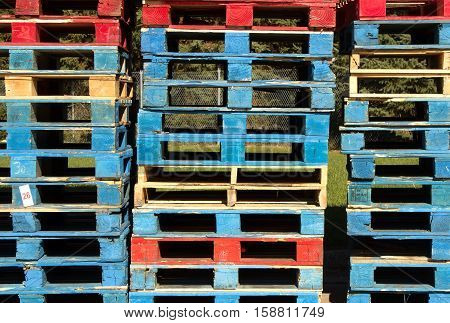 A stack of wooden pallets waiting to be taken to the recycler.