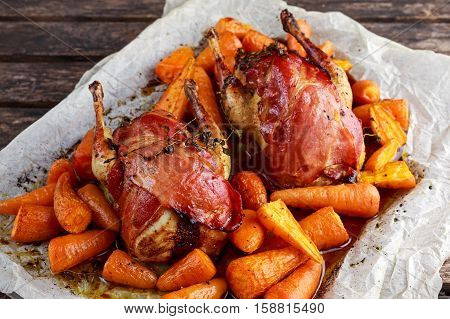 Ready to eat Roast partridges with bacon on crumpled paper