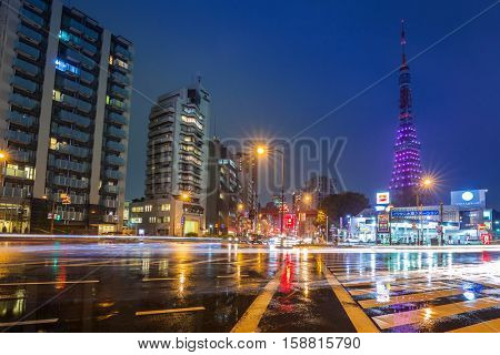 TOKYO, JAPAN - NOVEMBER 14, 2016: Cityscape of Tokyo with traffic lights and illuminated Tokyo tower, Japan. Tokyo Metropolis is both the capital and most populous city of Japan.