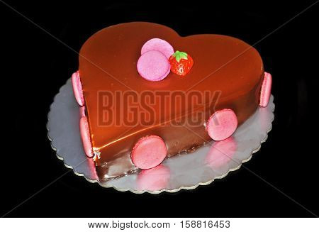 chocolate strawberry cake with macaroons and sugarpaste
