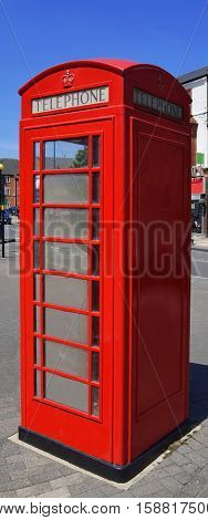 Red telephone booth in Harborne city center, United Kingdom