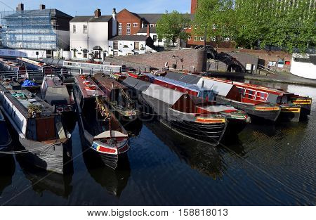 Boats on the Birmingham old canal in city center. The first canal was built in  Birmingham  between 1768 to 1772 .