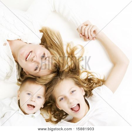 Mother with kids.Happy Smiling Family over white