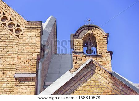 Belfry of the Church in Vepriai in Lithuania on a cloudless day