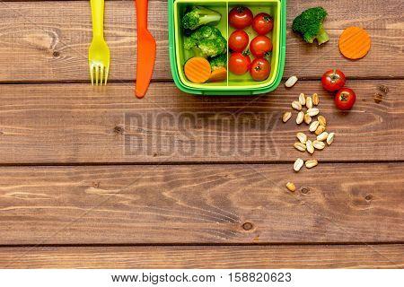 ingredients for children's lunch on dark wooden background top view