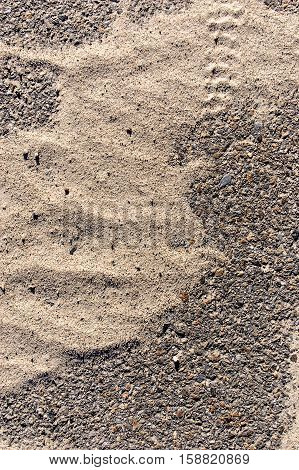 Asphalt road surface with film of thin sand over. A lot of space for text.