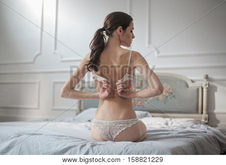 Girl getting dressed in bed