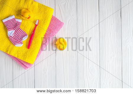 baby accessories for bath on wooden background top view