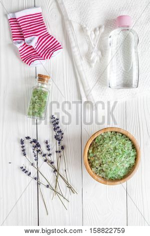 Natural organic cosmetics for baby with lavender on a wooden background