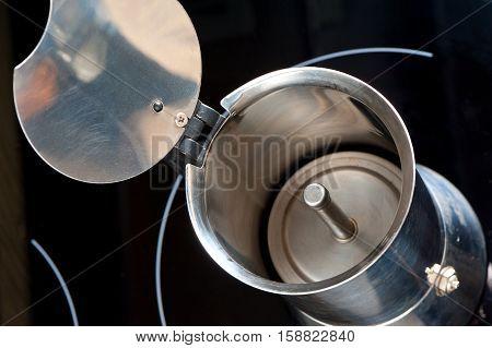 Inside aluminum moka pot or coffee maker.