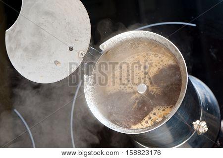 brewing morning hot coffee in moka pot