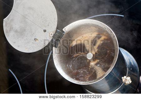 brewing hot coffee in a moka pot