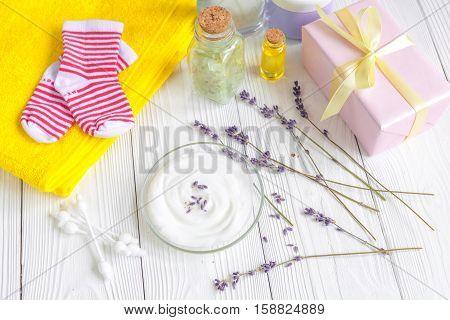 baby organic cream with lavender on shelf in bathroom.