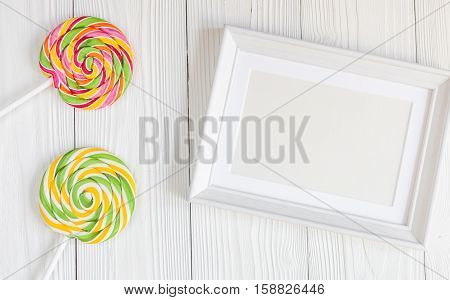 birth of child - blank picture frame on wooden background top view