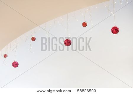 Christmas background for greeting card with empty place for copy paste. Decoration light and red garlands. Holiday illustration. Artistic retouching.
