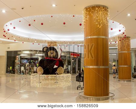 Johannesburg, South Africa - December 18, 2015: Christmas decoration Teddy Bear garlands and lights in the shopping mall Bedford Center. Christmas eve. Artistic retouching.