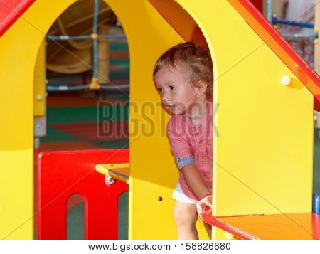 Little children activities, story of family games. Child playing outside on playground