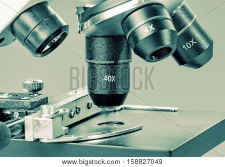 Microscope  in laboratory. Toned photo