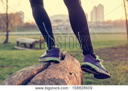 Balance training outdoor in a park. Bodyweight training.