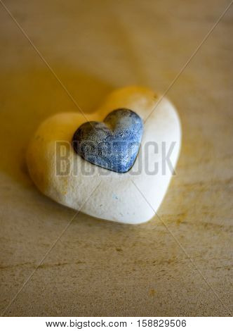 The white Stone Heart with a litle Heart in the middle