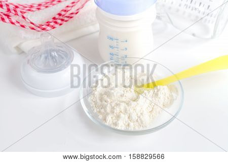 preparation of mixture baby feeding on white background close up