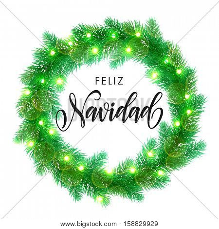 Spanish Merry Christmas text. Feliz Navidad calligraphy greeting. Decorative wreath of Christmas lights garland decoration. Spanish Christmas Feliz Navidad tree wreath of of pine, fir, spruce branches