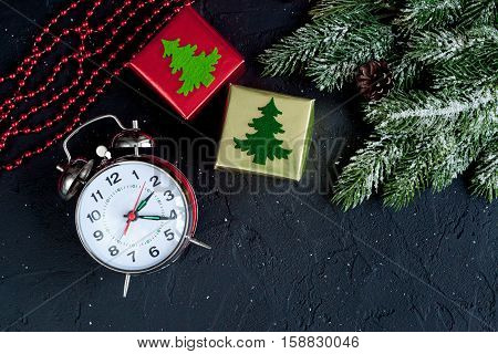 Christmas decorations, spruce branches on dark background top view - 2017 time to celebrate