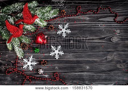 Christmas decorations New Year on dark wooden background top view.