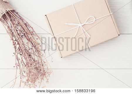 Gift boxes on the white wood,Cardboard boxes tied with string white top view