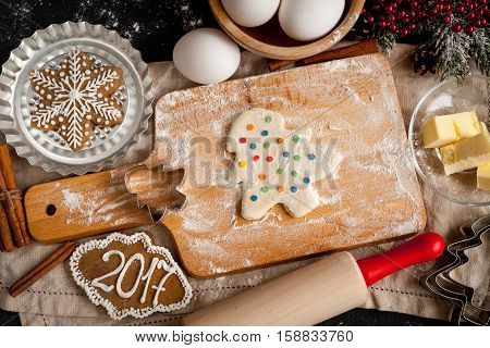 cooking christmas gingerbread on wooden background top view.