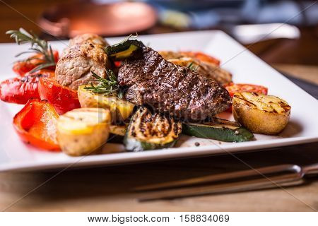 Beef Steak. Sirloin steak. Delicious juicy beef steak on fork. grill vegetables.