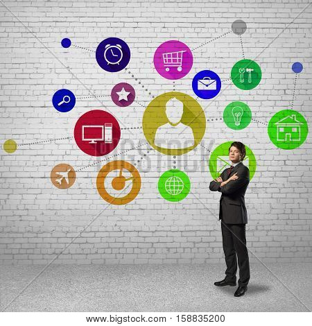 Businessman and color application icons at background