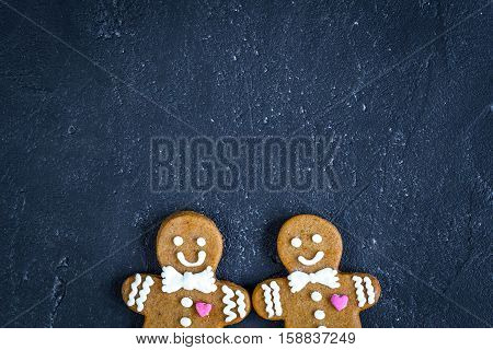 Christmas gingerbread on dark background top view.