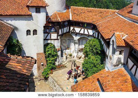 Romania, Bran 16 July, 2014: Tourists Admire The Bran Castle Also Know As Dracula Castle Near Brasov