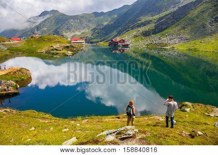 Balea Lake, Romania - 21 July, 2014: Unidentified Tourists Enjoy The Sights Of Balea Lake At 2,034 M