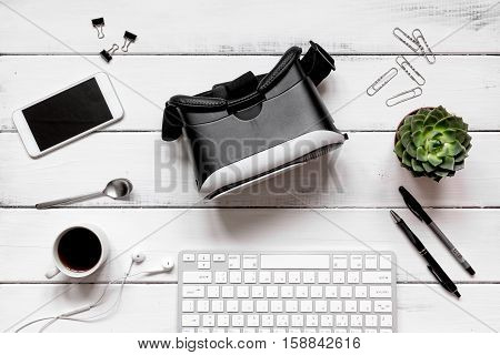 virtual reality glasses on man working wooden desk top view